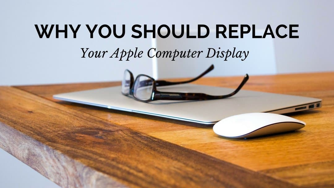 """A photo of an apple laptop and a mouse placed on top of a table with prescription glasses on top of the computer. The words """"Why You Should Replace Your Apple Computer Display"""" are displayed at the top of the screen center justified."""